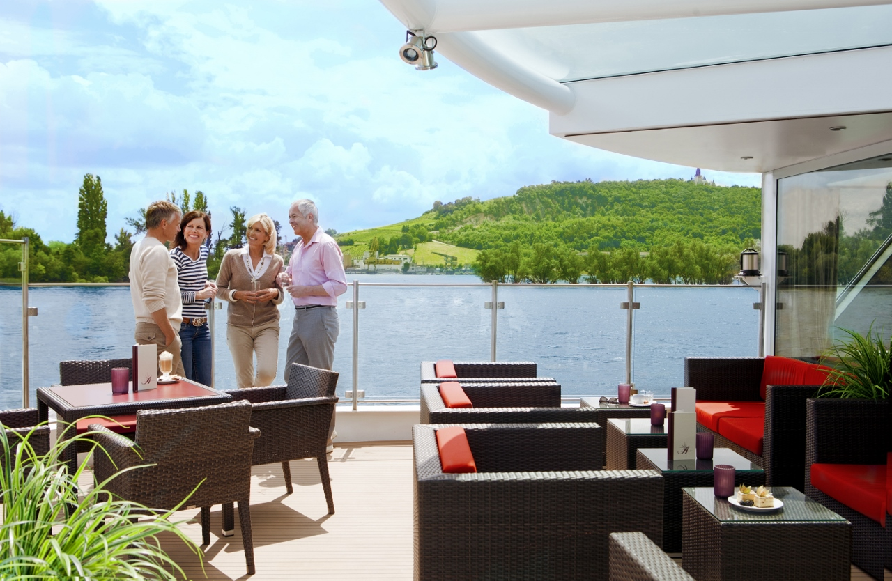 Passengers mingle onboard Amras Cruises