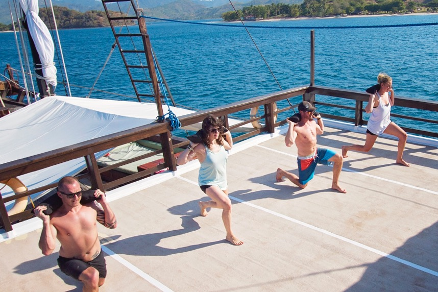 Passengers enjoy a CruiseFit workout on the deck