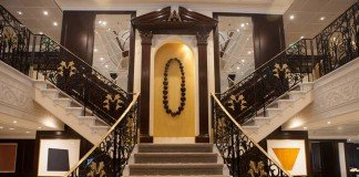 The staircase leading to Guest Relations on Azamara Journey.