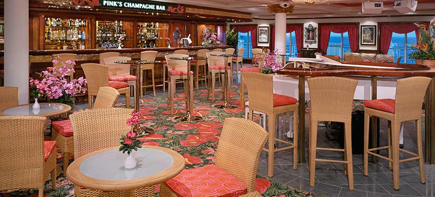 Toast with a glass of champagne at Pink's Champagne Bar on Pride of America.