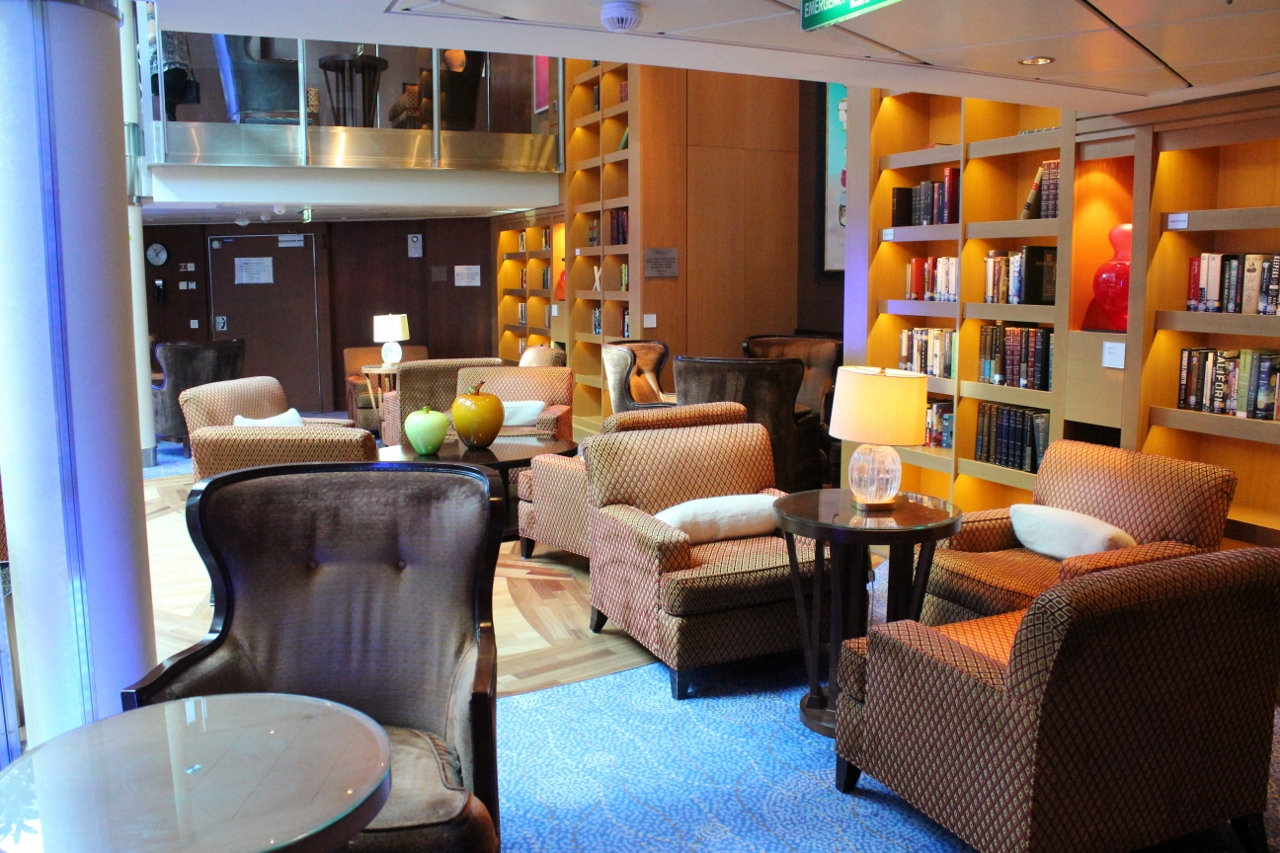 The Library aboard Celebrity Solstice provides guests a comfortable spot to relax with a book of choice