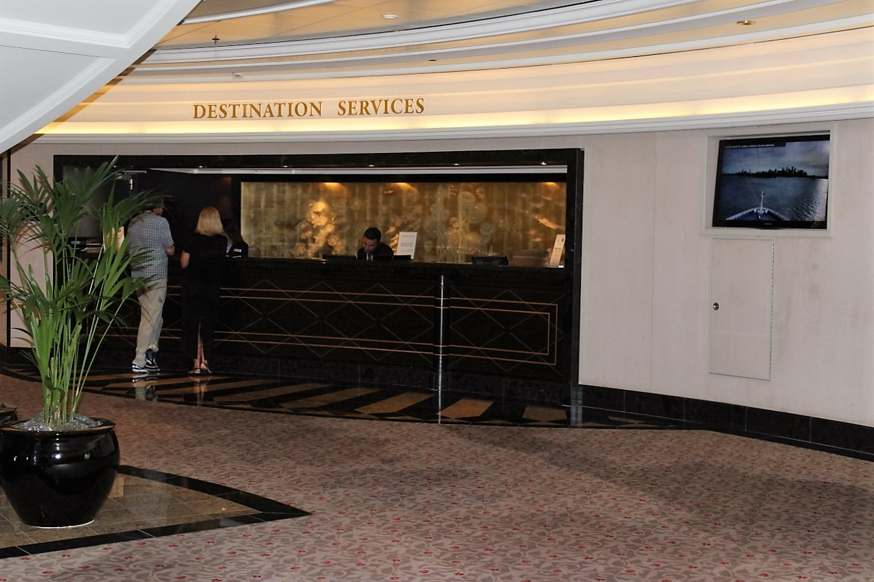 Guest services desks appear on every cruise ship, such as this one on Oceania Marina.
