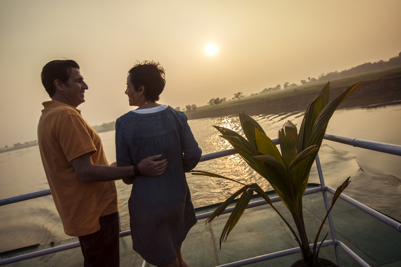 Enjoy the sunset on a G Adventures Indian river cruise.