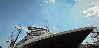 Queen Mary 2 emerges from dry dock.
