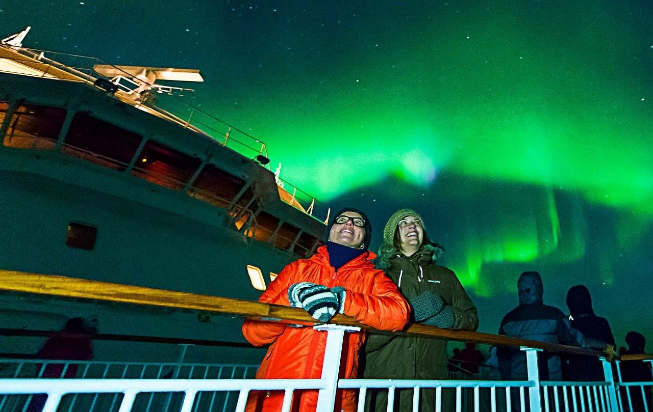 Hurtigruten passengers enjoy a particularly bright example of the Northern Lights.