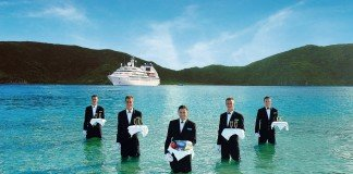 Seabourn invites its guests to enjoy some fine dining in a sheltered cove.