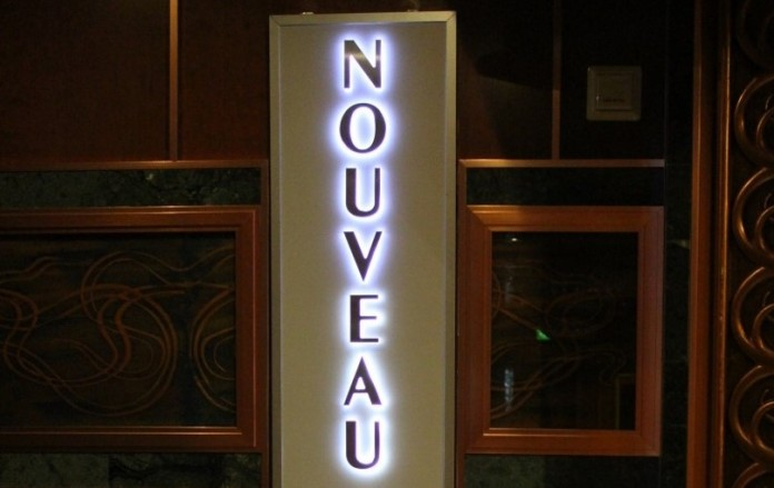 The entrance sign at Carnival Cruise Line's Nouveau Restaurant.