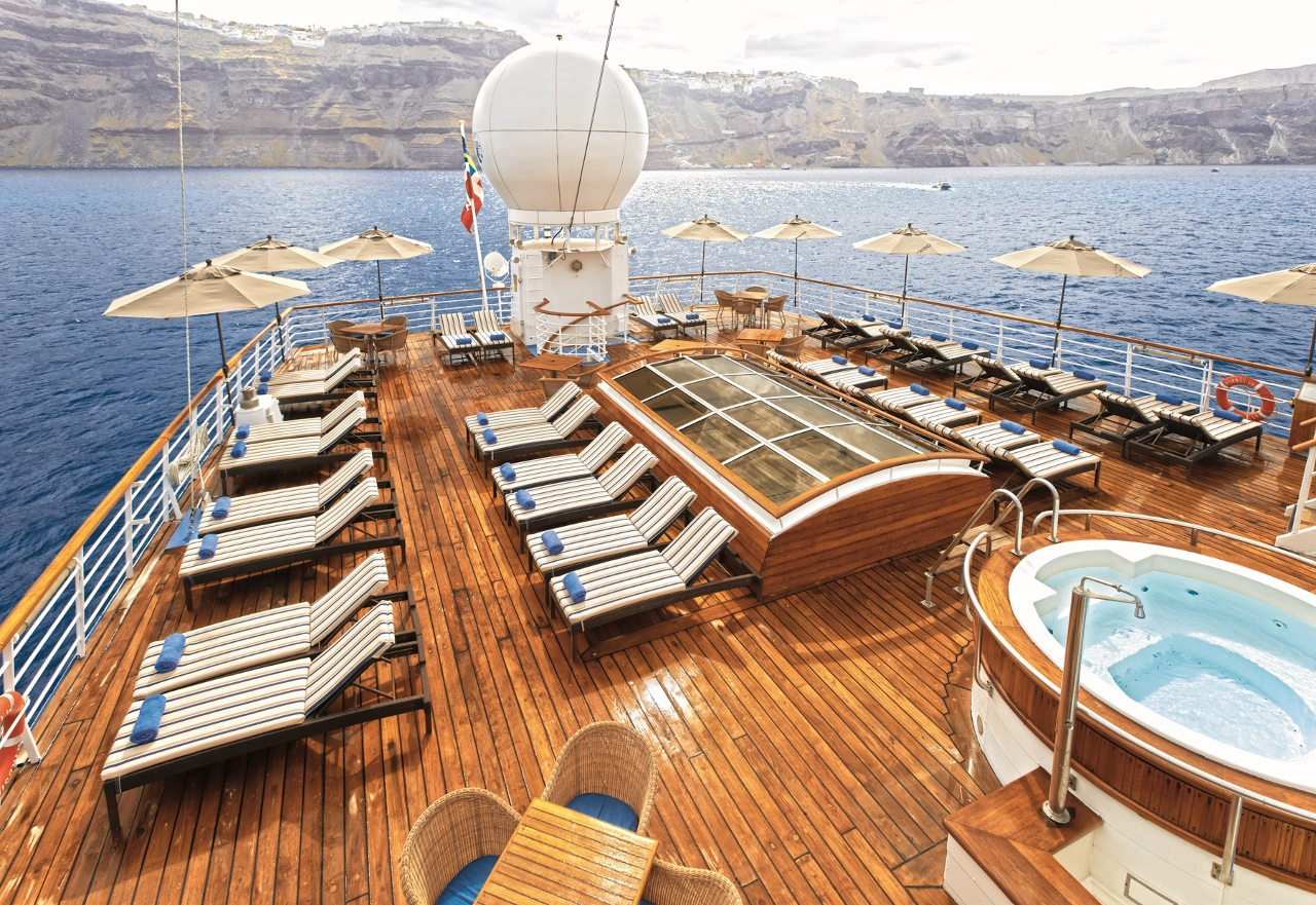 The rear deck of Windsurf features lounge chairs, with the swimming pool further along.