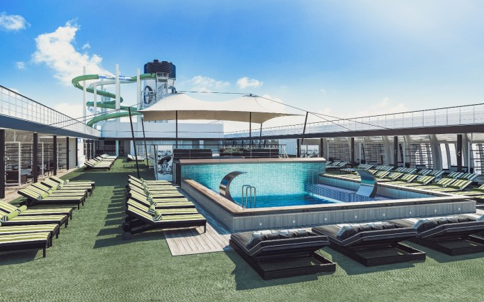 Top-deck pool area, with waterslides in the background.