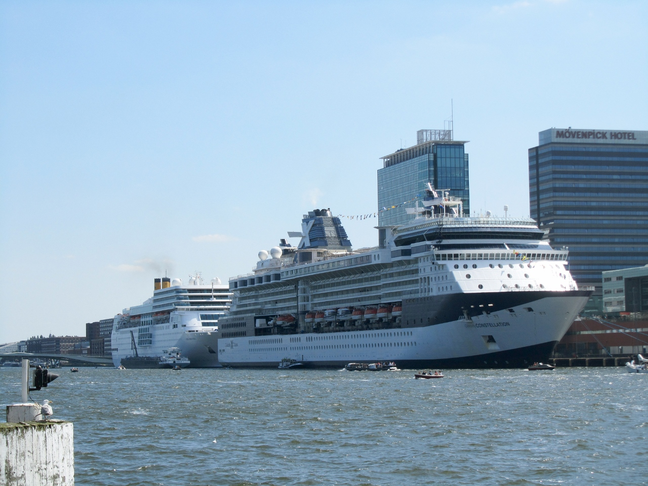 The Celebrity Constellation and Costa NeoRomantica are docked together in Amsterdam.