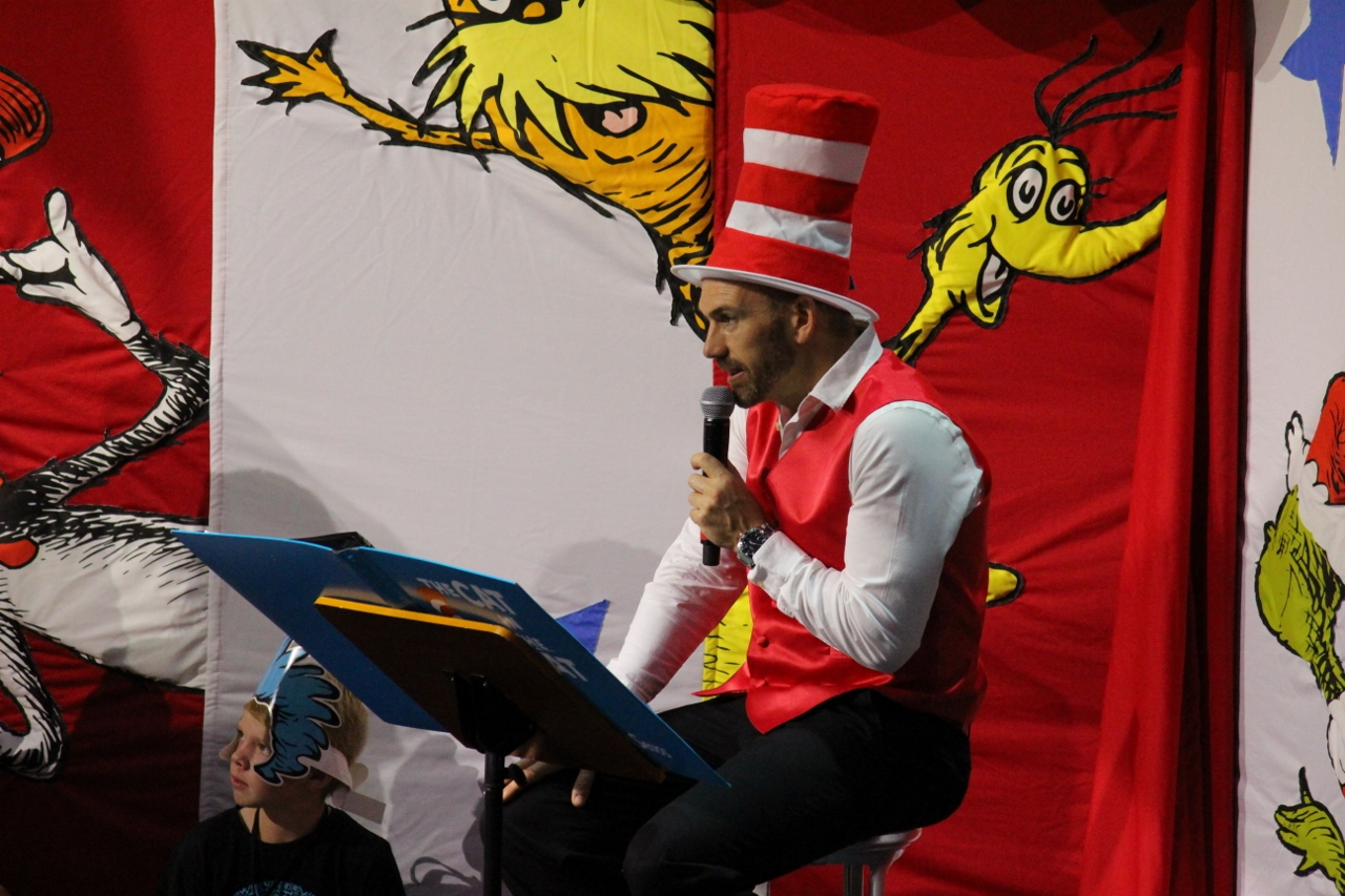 Channelling his inner child, Sharplin gets to play Dr Seuss to read stories to kids in the Camp Ocean Kids Club.