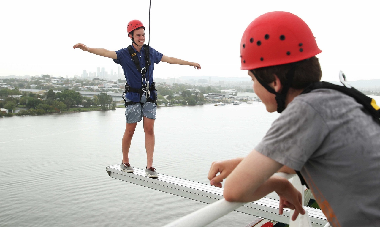 Safely harnessed, a guest on Pacific Dawn takes in a very different view of the sea on the P&O Edge Adventure Park.