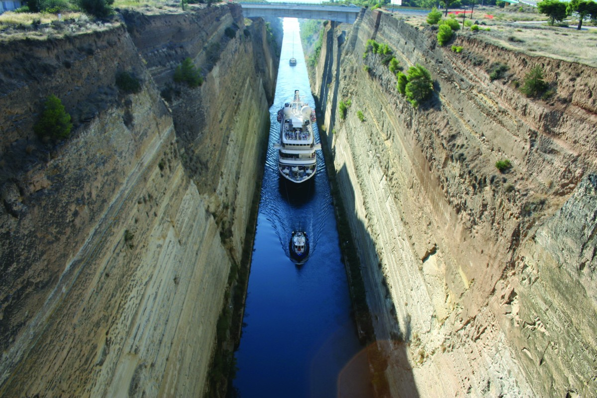 The Corinth Canal is a tight fit for most ships and serves as a key trading route for Greece.