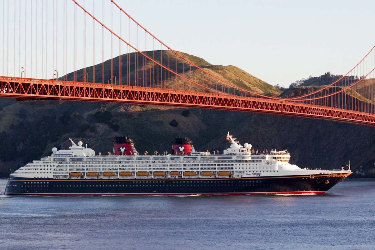 Disney Cruise Line vessel Disney Wonder sails under the Golden Gate Bridge on arrival into San Francisco.