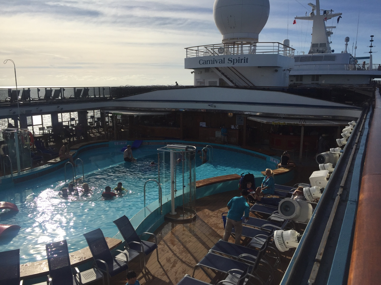 No cruise ships provide lifeguards at their pools, and parents/guardians are responsible for their children swimming.