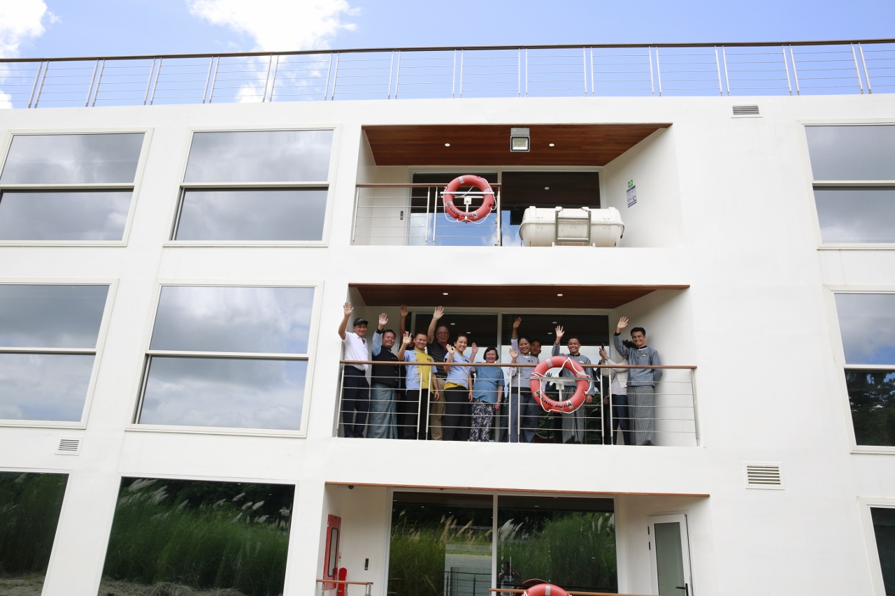 Guests on Scenic Aura celebrate the ship setting off from Pyay on its maiden voyage.