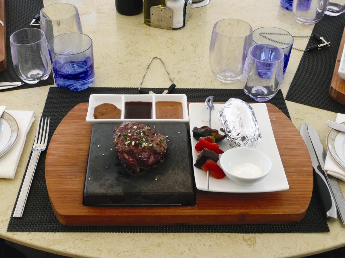 The hot lava stone cooking process is popular with guests at The Grill on Silversea Cruises.