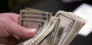 Counting out cash to spend on your cruise ship by pre-paying a cash account.