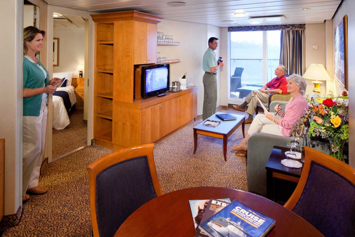 The living area of stateroom 9656 a two bedroom suite on Radiance of the Seas.