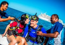 Passengers enjoying some diving from a Captain Cook Cruises vessel.