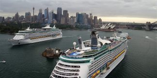 Royal Caribbean's Voyager of the Seas and Explorer of the Seas pass each other in Sydney Harbour.